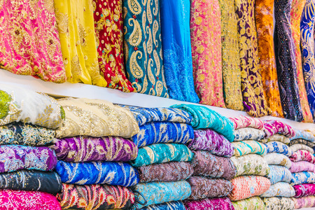 Traditional oriental cloth sold in a store in old town Dubai, United Arab Emirates