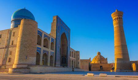 Po-i-Kalan or Poi Kalan, an Islamic religious complex located around the Kalan minaret in Bukhara, Uzbekistan. Фото со стока - 124953812