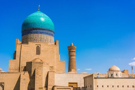 Architecture of Po-i-Kalan or Poi Kalan, an Islamic religious complex located around the Kalan minaret in Bukhara, Uzbekistan. Фото со стока - 124953954