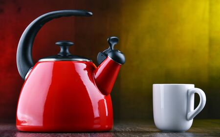 Traditional stainless steel stovetop kettle with whistle of two litres capacity Stock Photo
