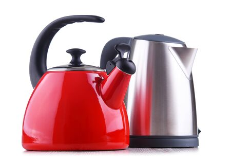 Traditional stovetop kettle with whistle and modern electric cordless kettle isolated on white