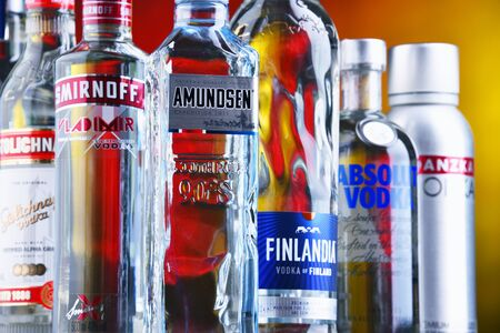 POZNAN, POL - JUN 5, 2019: Bottles of several global brands of vodka, the world's largest internationally traded spirit with the estimated sale of about 500 million nine-liter cases a year.