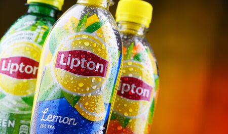 POZNAN, POL - JUN 5, 2019: Plastic bottles of Lipton Ice Tea, a soft drink brand sold by Lipton and belonging to Unilever, a British-Dutch multinational consumer goods company. 에디토리얼