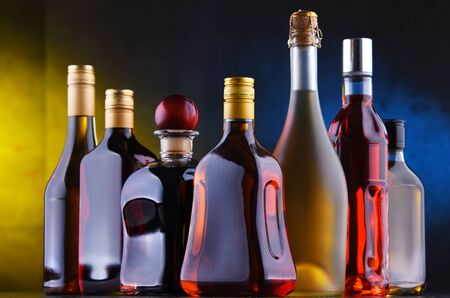 Composition with bottles of assorted alcoholic beverages. Stock Photo