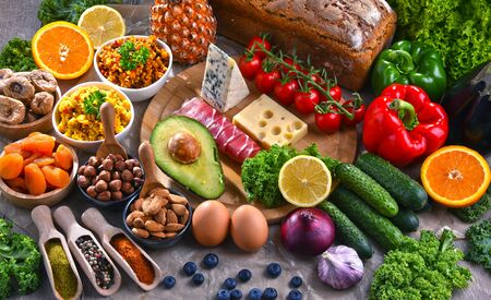 Composition with assorted food products on kitchen table. Banco de Imagens
