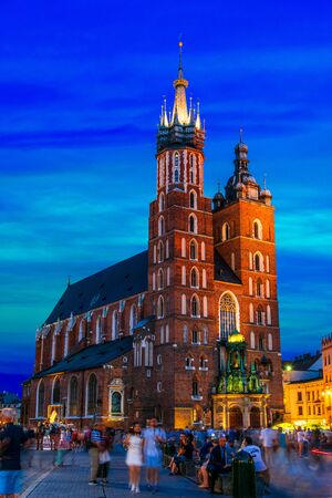 KRAKOW, POL - JUL 25, 2019: Main Market Square with Saint Mary's Basilica in Old Town of Krakow, Poland