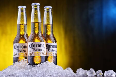 POZNAN, POL - AUG 22, 2019: Bottles of Corona Extra, one of the top-selling beers worldwide, a pale lager produced by Cerveceria Modelo in Mexico Editöryel