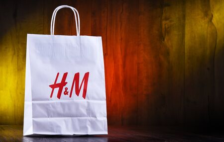 POZNAN, POL - AUG 28, 2019: H and M paper shoping bag; Hennes and Mauritz AB is a Swedish multinational clothing-retail company, It operates over 4,500 stores in 62 countries worldwide Redakční
