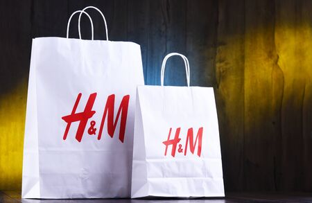 POZNAN, POL - AUG 28, 2019: H and M paper shoping bags; Hennes and Mauritz AB is a Swedish multinational clothing-retail company, It operates over 4,500 stores in 62 countries worldwide