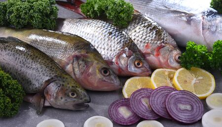 Different sorts of fish on kitchen table, Stock fotó
