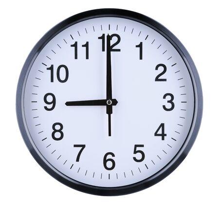 Orologio da parete isolato su sfondo bianco. Nove in punto.