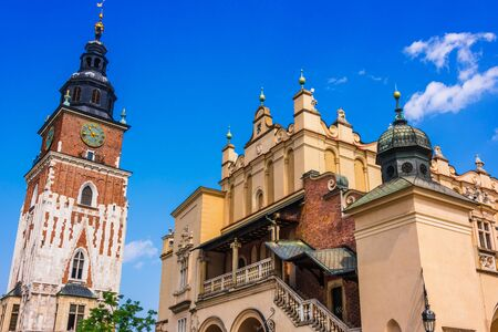 Main Market Square with Town Hall Tower and Cloth Hall in Old Town of Krakow, Poland