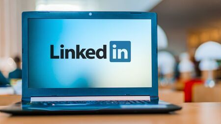 POZNAN, POL - DEC 11, 2019: Laptop computer displaying logo of LinkedIn, an American business and employment-oriented service that operates via websites and mobile apps