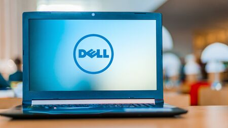 POZNAN, POL - DEC 11, 2019: Laptop computer displaying logo of Dell, an American multinational computer technology company that develops, sells, repairs, and supports computers and related products and services Banque d'images - 140143417