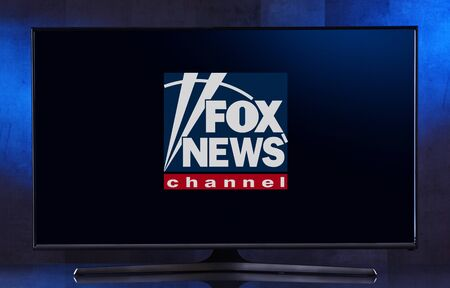 POZNAN, POL - FEB 04, 2020: Flat-screen TV set displaying logo of Fox News, an American conservative cable television news channel, owned by the Fox News Group