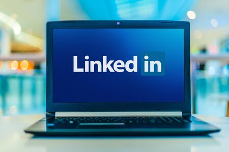 POZNAN, POL - JAN 30, 2020: Laptop computer displaying logo of LinkedIn, an American business and employment-oriented service that operates via websites and mobile apps Editorial