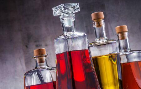 Composition with carafe and bottles of assorted alcoholic beverages. Reklamní fotografie
