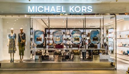 SINGAPORE - MAR 5, 2020: Front entrance to Michael Kors store in Singapore shopping mall Sajtókép