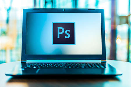 POZNAN, POL - MAR 24, 2020: Laptop computer displaying logo of Adobe Photoshop, a raster graphics editor developed and published by Adobe Inc Editorial