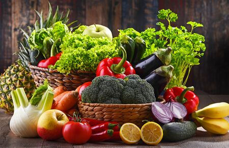 Composition with assorted organic vegetables and fruits. Stock Photo