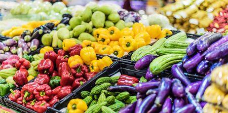 Assorted fresh vegetables put up for sale in supermarket. Banco de Imagens