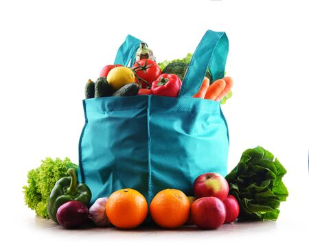 Shopping bag with vegetables and fruits on white background