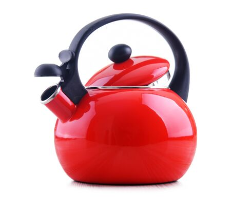Traditional stainless steel stovetop kettle with whistle isolated on white background