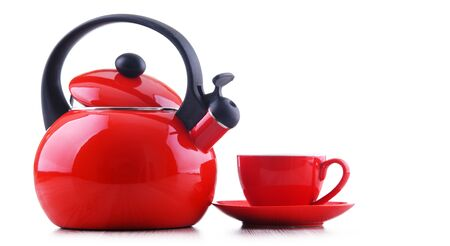 Cup of coffee and stainless steel stovetop kettle with whistle isolated on white Stockfoto