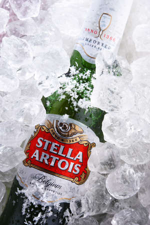 POZNAN, POL - MAY 28, 2020: Bottle of Stella Artois, prominent brand of Anheuser-Busch InBev. It is a pilsner brewed in Leuven, Belgium, since 1926 Editorial