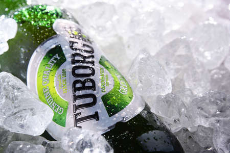 POZNAN, POL - JUN 10, 2020:  Bottle of Tuborg beer, produced by a Danish brewing company founded in 1873 near Copenhagen