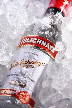 POZNAN, POL - MAY 28, 2020: Bottle of Stolichnaya, popular brand of Russian vodka made of wheat and rye grain 에디토리얼