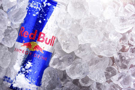 POZNAN, POL - JUN 10, 2020: Can of Red Bull, an energy drink sold by Red Bull GmbH, an Austrian company created in 1987