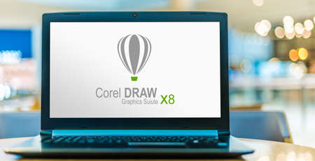 POZNAN, POL - JUN 16, 2020: Laptop computer displaying logo of CorelDRAW, a vector graphics editor developed and marketed by Corel Corporation