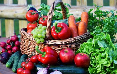 Variety of fresh organic vegetables in wicker basket.