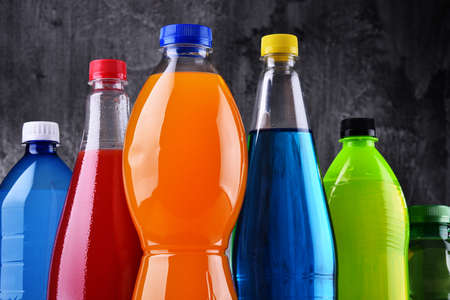 Plastic bottles of assorted carbonated soft drinks in variety of colors Stock Photo