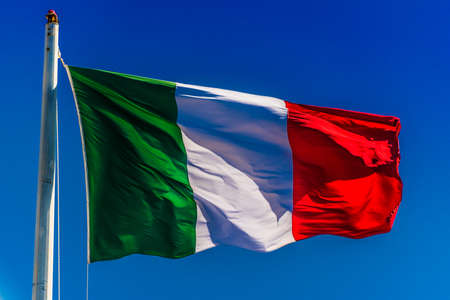 National flag of Italy waving in the wind over blue sky Stockfoto