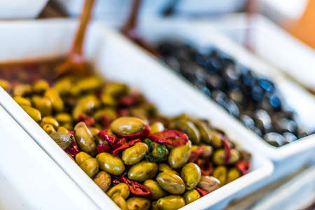 Assorted olives put up for sale on the italian street market stall.