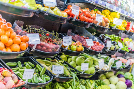 Fresh vegetables and fruits put up for sale in supermarket.