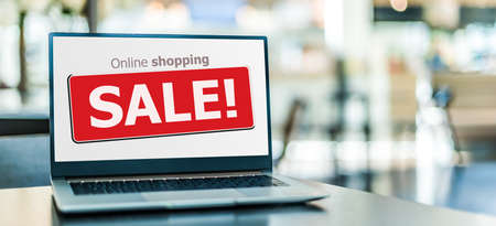 Laptop  displaying a commercial sale sign on internet shopping website