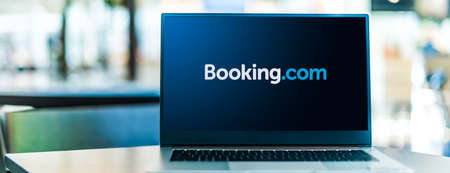 POZNAN, POL - SEP 23, 2020: Laptop computer displaying  of Booking.com, a travel fare aggregator website and travel metasearch engine for lodging reservations Sajtókép