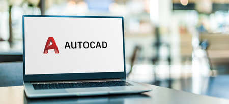 POZNAN, POL - SEP 23, 2020: Laptop computer displaying of AutoCAD, a commercial computer-aided design (CAD) and drafting software application, developed and marketed by Autodesk