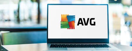 POZNAN, POL - SEP 23, 2020: Laptop computer displaying logo of AVG AntiVirus, a line of antivirus software developed by AVG Technologies, a subsidiary of Avast