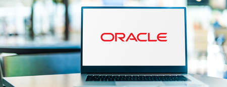 POZNAN, POL - SEP 23, 2020: Laptop computer displaying of Oracle Corporation, an American computer technology corporation headquartered in Redwood Shores, California