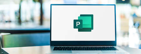 POZNAN, POL - SEP 23, 2020: Laptop computer displaying of Microsoft Publisher, a desktop publishing application, part of the Office family software and services developed by Microsoft Sajtókép