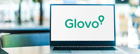 POZNAN, POL - SEP 23, 2020: Laptop computer displaying of Glovo, an on-demand courier service that purchases, picks up, and delivers products ordered through its mobile app