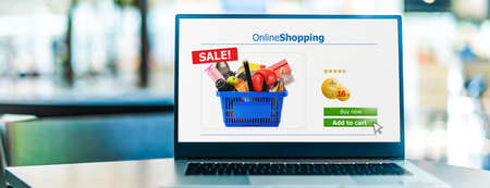 Laptop computer displaying an online shopping website. E-commerce