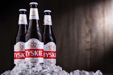 POZNAN, POL - OCT 2, 2020: Bottles of Tyskie, best selling brand of beer in Poland, produced by Kompania Piwowarska, a subsidiary of Asahi Breweries