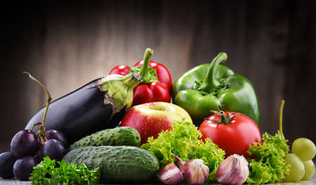 Composition with fresh organic vegetables and fruits.