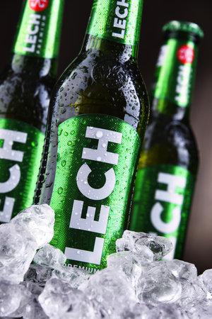 POZNAN, POL - OCT 2, 2020: Bottles of Lech, a brand of Polish beer produced by Kompania Piwowarska, a subsidiary of Asahi Breweries