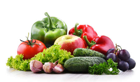 Composition with fresh vegetables and fruits isolated on white background
